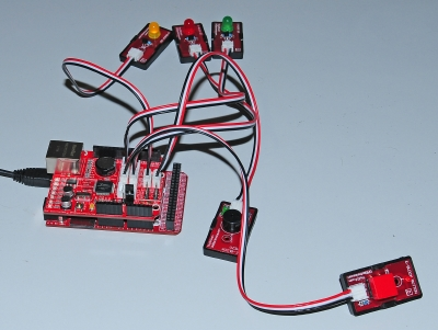 Picture of a FEZ Panda II board with 3 LEDs,a button and a buzzer